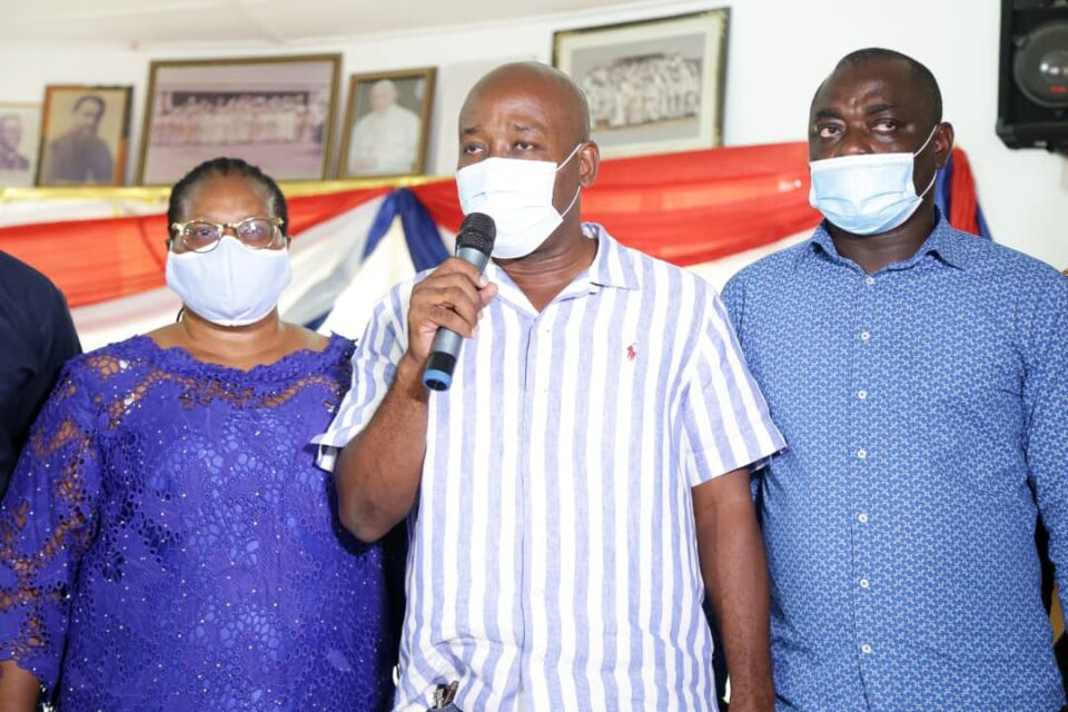 Makafui Woanya, NPP Regional Chairman & Chair of the Campaign team, flanked by Regional Secretary (R)and Women Organizer (L)